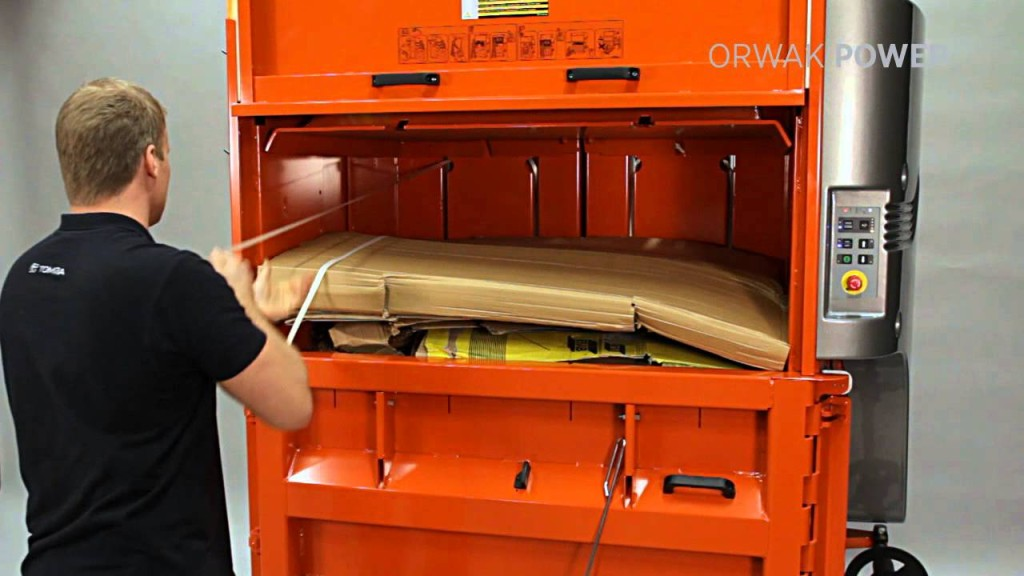 compactadora orwak trabajando